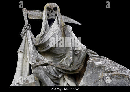 Death personified as a skeleton with a cloak and scythe This picture of weathered sculpture was taken in a cemetery. - Stock Photo