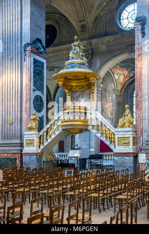 1788-1789 historic, ornate, golden pulpit designed by Charles de Wailly in the Church of Saint-Sulpice in Paris, - Stock Photo