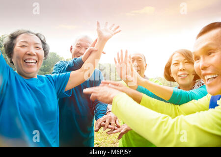 happy Senior Group Friends Exercise and   having fun - Stock Photo
