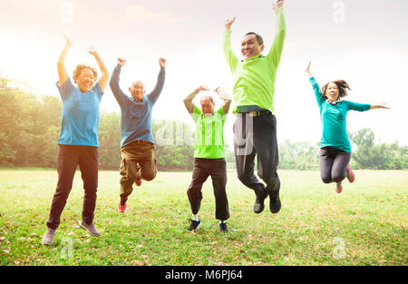 happy Senior Group Friends jumping and   having fun - Stock Photo