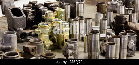 Vintage antique automotive machine shop stainless steel sleeved hydraulic cylinders and tubing assortment - Stock Photo