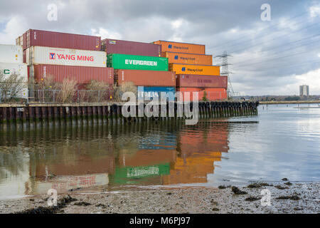 Stacked shipping containers in Eling along the River Test near Southampton, England, UK - Stock Photo