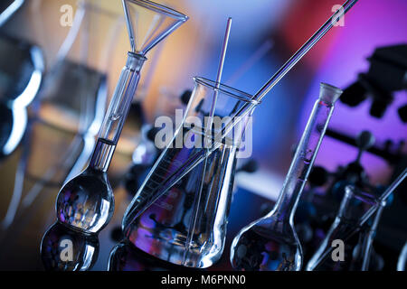 Science concept background. Microscope and laboratory glassware composition. - Stock Photo