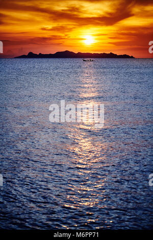 Orange and red sunset sky on beach, A colorful sunset in the clouds, stunning natural phenomenon, Skyscape from - Stock Photo