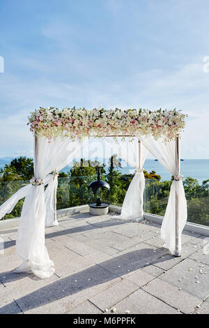 The wedding venue on the hill with panoramic ocean view, The arch in white decorated with flowers, floral. Koh Samui, - Stock Photo