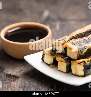 Tofu fried in nori. Served with sauce. Japanese Cuisine. Asian food concept - Stock Photo