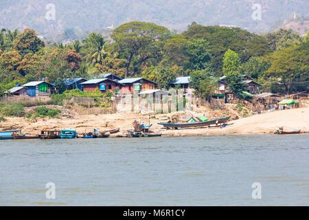 Daily life in Myanmar - riverside village along the Irrawaddy River, Mingun, Myanmar (Burma), Asia in February - Stock Photo