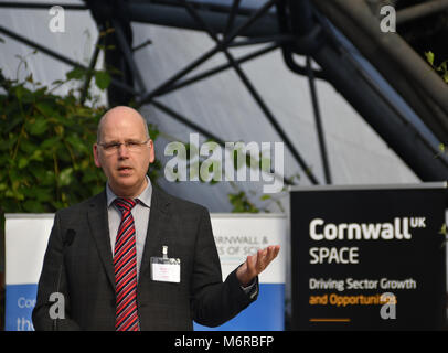 Eden Project, Cornwall UK. 6th March 2018. Ian Jones, the CEO of Goonhilly Earth Station, was one of the speakers at a conference to discuss the future of the space industry in Cornwall. Ian is seen here holding up a print out of the entire space industry to date. Other speakers included Miles Carden, the director of Spaceport Cornwall. The space sector in Cornwall could be worth more than £1 billion in 2030 according to the Cornwall and Isles of Scilly LEP. Credit: Simon Maycock/Alamy Live News Stock Photo