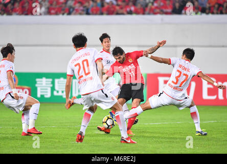 Guanghzou, China's Guangdong province. 6th Mar, 2018. Ricardo Goulart (2nd R) of Guangzhou Evergrande competes during - Stock Photo