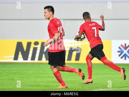 Guanghzou, China's Guangdong province. 6th Mar, 2018. Alan (R) of Guangzhou Evergrande celebrates after scoring - Stock Photo