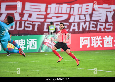 Guanghzou, China's Guangdong province. 6th Mar, 2018. Ricardo Goulart of Guangzhou Evergrande celebrates after scoring - Stock Photo