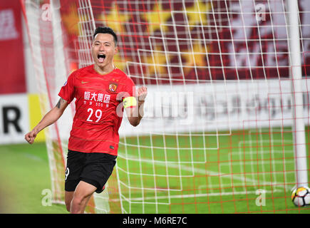 Guanghzou, China's Guangdong province. 6th Mar, 2018. Gao Lin of Guangzhou Evergrande celebrates after scoring during - Stock Photo