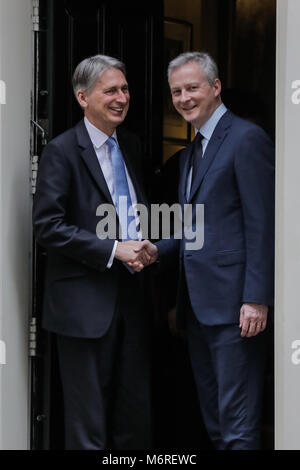 10 Downing Street, London, UK. 6th March 2018. French Finance Minister, Bruno Le Maire, shakes hands with Chancellor - Stock Photo