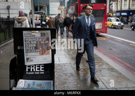 London, UK 6th March 2018: Londoners pass-by the London newspaper Evening Standard's latest headline about ex-Russian - Stock Photo