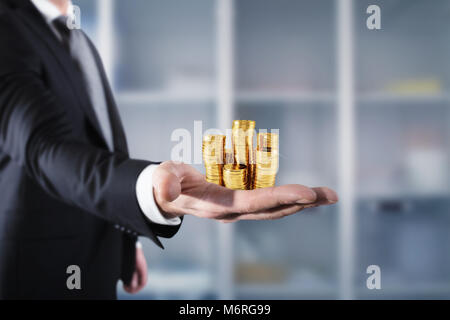 Businessman hold piles of money. Concept of success and company growth - Stock Photo