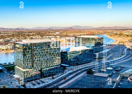An overlook from atop Mountain Butte of sunset over downtown Phoenix Arizona - Stock Photo