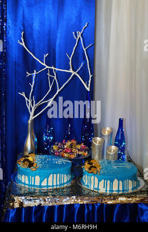 decoration, celebration, entertainment concept. on the table covered with beautiful thin fabric there are burning - Stock Photo