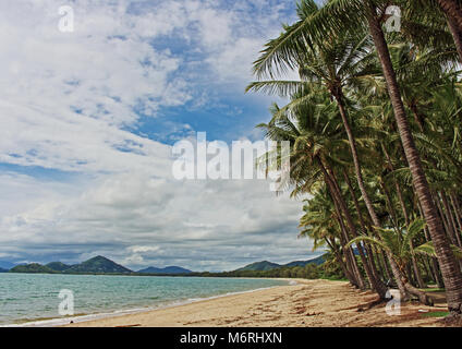 Palm Cove Beach view as a tropical cyclone 'maybe' forms way out in the Coral Sea - Stock Photo