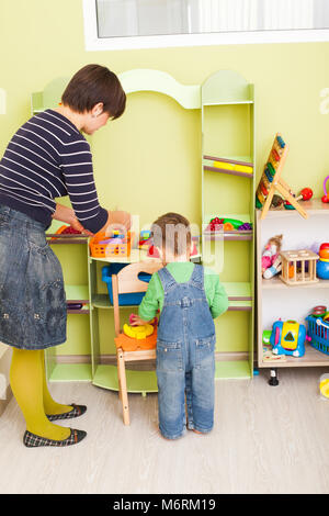 Tidy up own toys - Stock Photo