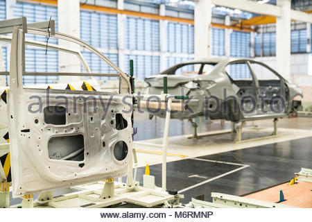 The simulated line door's parts (doors) prepared for installation at automotive plant. - Stock Photo