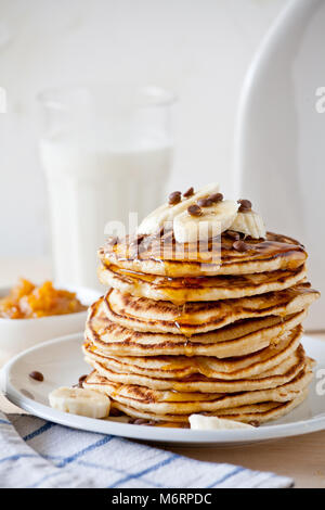 Stack of homemade pancakes with fresh fruits - Stock Photo