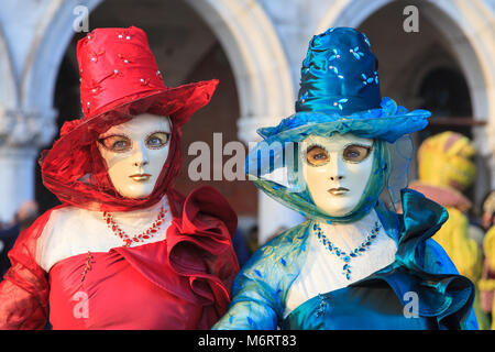 Two women in beautiful fancy dress costumes and mask at the Venice Carnival, Carnivale di Venezia, Veneto, Italy - Stock Photo