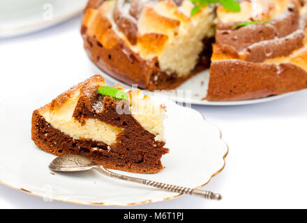 Isolated  two-tone homemade color cake with mint leaves - Stock Photo