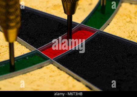 Success hitting target aim goal achievement concept background - darts in bull's eye close up - Stock Photo