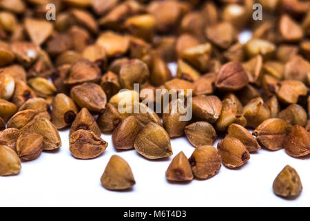 Pile of buckwheat seeds isolated over the white background. - Stock Photo