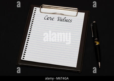 Top view of clipboard and white sheet written with Core Values on black background. Business Concept. - Stock Photo