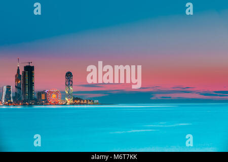 Batumi, Adjara, Georgia. Colorful Bright Evening Sky Over Resort Town At Sunset Or Sunrise. Cityscape With Modern - Stock Photo