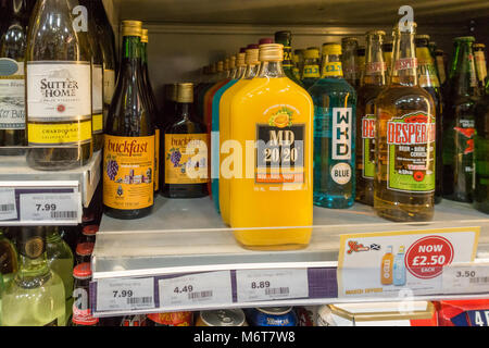 Alcohol, including bottles of Buckfast, MD 50/50 and WKD on sale in off licence in Glasgow, Scotland, UK - Stock Photo
