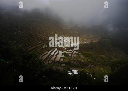 Batad Rice Terraces found in Banaue in the Philippines, Captured during the day just after the rain, foggy morning, - Stock Photo