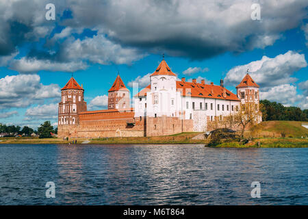 Mir, Belarus. Mir Castle Complex From Side Of Lake. Architectural Ensemble Of Feudalism, Cultural Monument, UNESCO - Stock Photo