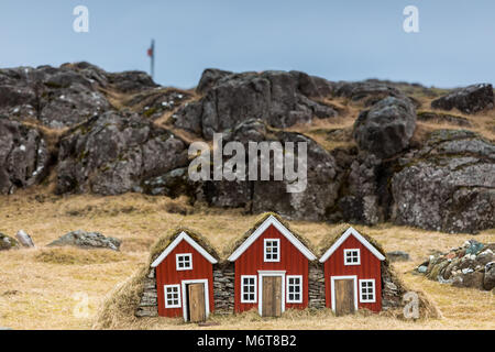 Traditional Icelandic Turf Houses. A row of traditional Icelandic houses with the roofs covered in turf for insulation. - Stock Photo