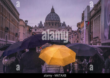 A group of tourists glance at the Vatican between their map before heading towards their next destination. - Stock Photo