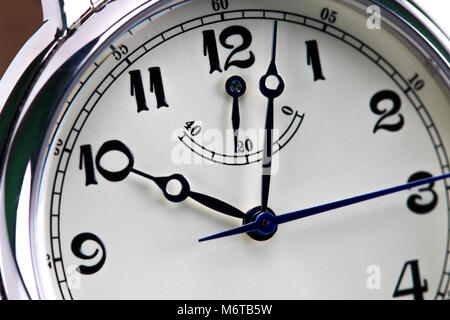 Close-up of a men's wrist watch isolated on white background. - Stock Photo