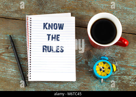 know the rules- text on notepad with, cup of coffee on wooden desk. Top view - Stock Photo