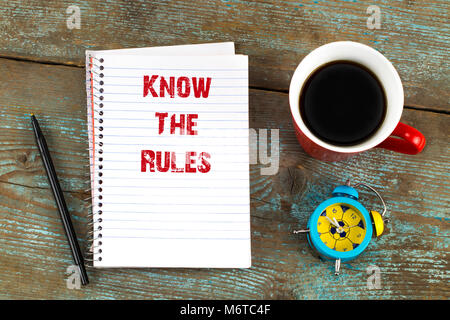 know the rules- text on notepad with, cup of coffee on wooden desk. Top view. - Stock Photo