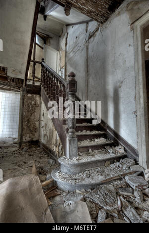 Ruined staircase in an abandoned house after water damage - Stock Photo