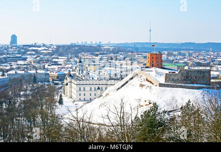 Beautiful panormaic view of Vilnius in winter from Three Crosses Hill, with Gediminas' Tower and TV tower - Stock Photo