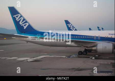 23.12.2017, Osaka, Japan, Asia - ANA passenger planes are seen parked on the apron at Kansai International Airport. - Stock Photo