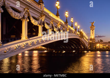 Pont Alexandre III bridge and Seine River at sunset. 8th Arrondissement, Paris, France - Stock Photo