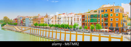 Seville, Spain - June 08, 2017 : View from the coast of the Guadalquivir to the Triana district in Seville. Spain. - Stock Photo