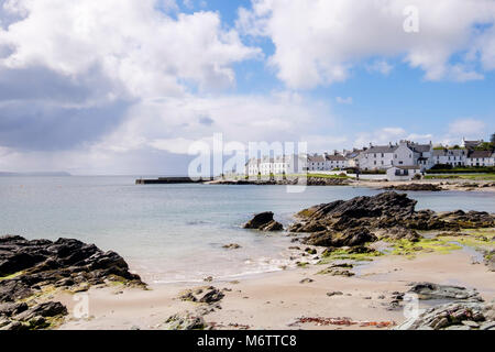View along small sandy beach on rocky coast of Loch Indaal to Port Charlotte Isle of Islay Argyll and Bute Inner - Stock Photo