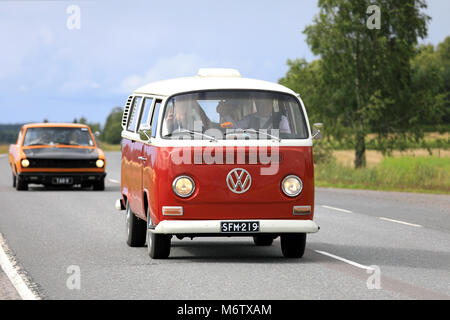 SOMERO, FINLAND - AUGUST 5, 2017: Classic Volkswagen red and white Type 2 camper van moves along highway on Maisemaruise - Stock Photo