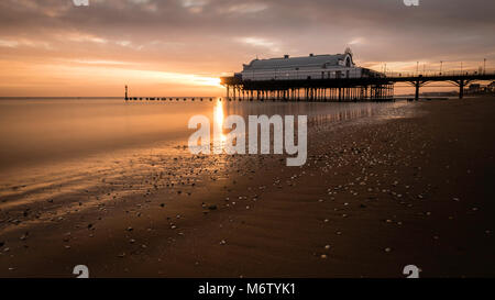 Sunrise at Cleethorpes Pier and Beach - Stock Photo