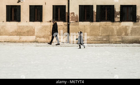 VENICE, ITALY - 28th FEBRUARY/01st MARCH 2018 A little girl runs in the snow during a snowfall in Venice, Italy. - Stock Photo