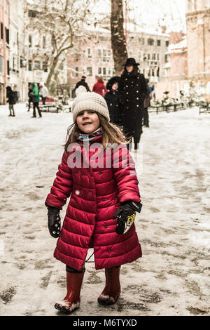 VENICE, ITALY - 28th FEBRUARY/01st MARCH 2018 A little girl walks in the snow after a snowfall in Venice, Italy. - Stock Photo