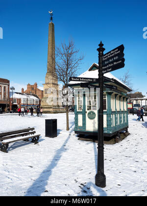 Snow covered Market Place Obelisk and Cabmans Shelter in Winter Ripon North Yorkshire England - Stock Photo
